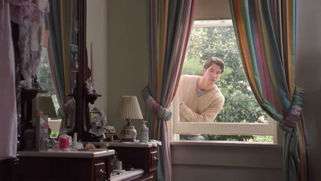Dylan-McDermott-climbing-in-window-Jackson-room